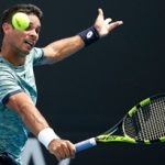 MELBOURNE, AUSTRALIA - JANUARY 17:  Rogerio Dutra Silva of Brazil plays a backhand during his first round match against Jared Donaldson of the USA on day two of the 2017 Australian Open at Melbourne Park on January 17, 2017 in Melbourne, Australia.  (Photo by Darrian Traynor/Getty Images)